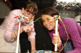 Teacher showing teen science project