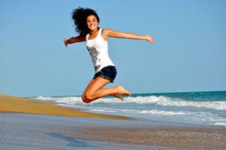 Happy woman combating depression on beach