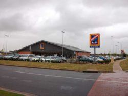Aldi grocery store with now open sign