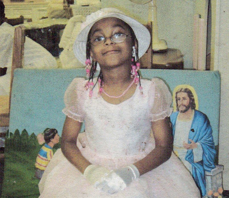 The Best Thing A Father Can Do For His Daughter, Young girl in church picture of Jesus in background