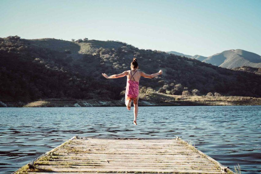 summer safety tips girl jumping into lake