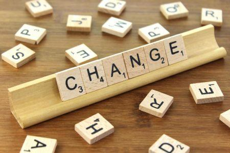 Change is good written with scrabble pieces